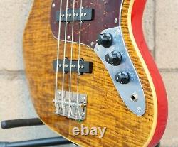 AIO JB4 4 String Jazz Bass Tiger Amber withSKB Shaped Case